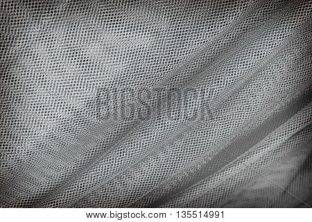 Mesh fabric texture or background, gray color.