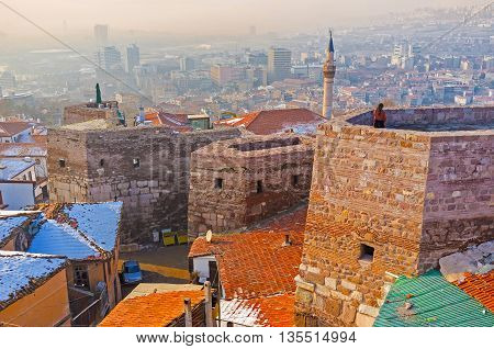 The city is covered with the light winter haze surrounding the Castle Hill Turkey.