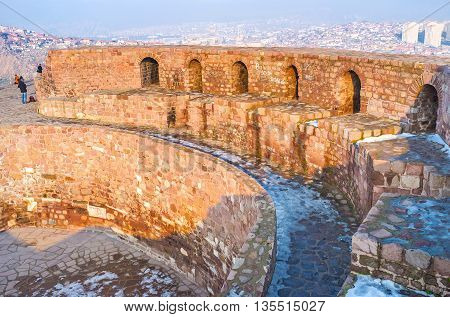The huge walls of the old citadel rise over the city of Ankara Turkey.