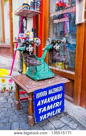 ANKARA TURKEY - JANUARY 16 2015: The vintage machine for making repair and stretching shoes is the nice commercial for the traditional workshop in the city center on January 16 in Ankara.