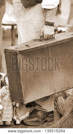 Poor Immigrant With Old Leather Suitcase Waiting To Boarding