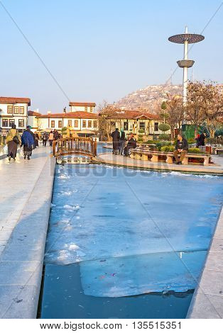 ANKARA TURKEY - JANUARY 16 2015: The small pond located next to the Haci Bayram Mosque and Augustus Temple is covered with a thick layer of ice on January 16 in Ankara.