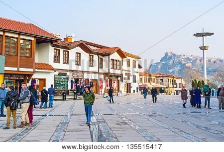 ANKARA TURKEY - JANUARY 16 2015: The white renovated cottages with cafes and stores surround the Haci Bayram Square the most popular tourist place in city on January 16 in Ankara.