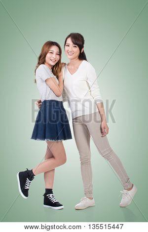 Cheerful Asian women, full length portrait.