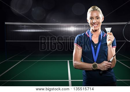 Composite image of badminton player posing with gold medal around his neck against badminton field