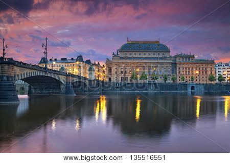 Prague. Image of Prague riverside with reflection of the city in Vltava River and National Theatre.