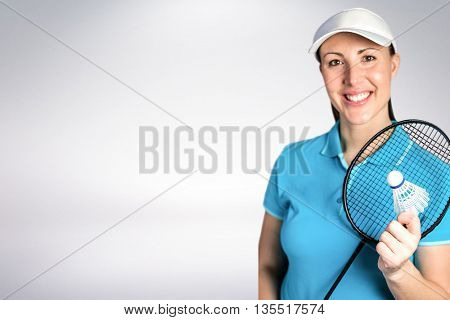 Composite image of badminton player holding badminton racket and shuttlecock against white background
