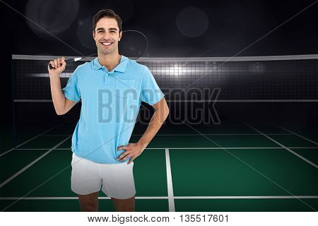Composite image of badminton player standing with hand on hip on badminton field