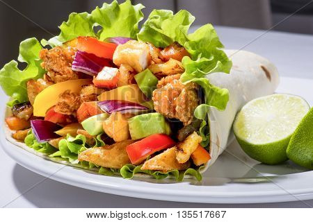 Close up of a kebab with chicken coated with breadcrumbs