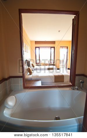 Classic bathroom with a large window and parquet floor