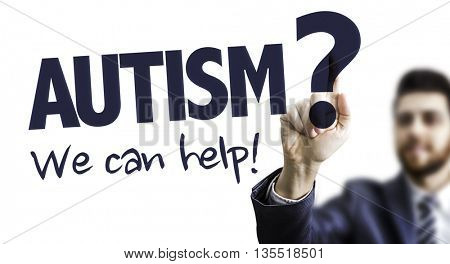 Business Man Pointing the Text: Autism? We Can Help!