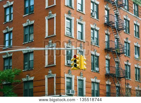 Building facade and traffic light in New York City, USA