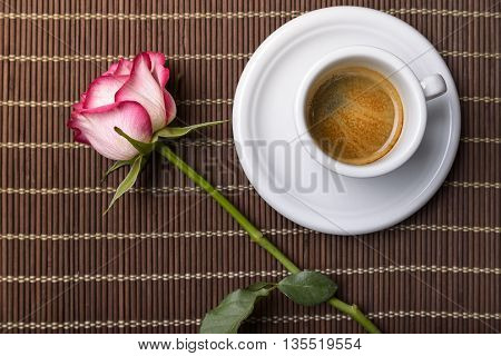 coffee and rose on placemat for romantic breakfast