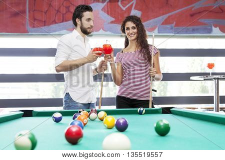 Happy Couple Toast After A Game Of Billiards