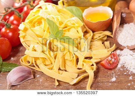 raw tagliatelle and ingredient