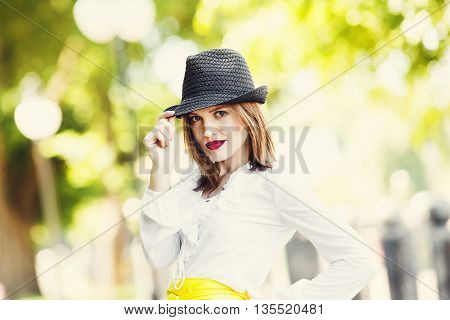 Sexual woman in fedora hat. Fashionable and stylish woman. Modern fashion model, trendy, fancy girl. Young attractive woman portrait.