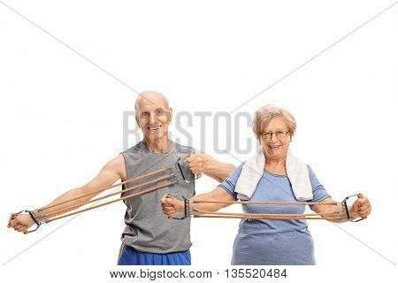 Senior man and woman exercising with a resistance band isolated on white background