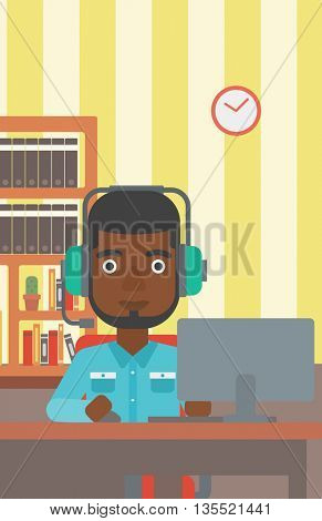 An african-american man in headphones sitting in front of computer monitor with mouse in hand on the background of living room vector flat design illustration. Vertical layout.