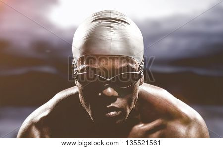 Swimmer ready to dive against road leading out to the horizon at night