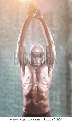 Composite image of swimmer ready to dive against swimming pool