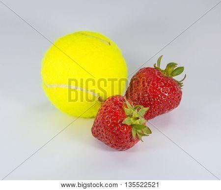 Wimbledon - A green tennis ball with 2 strawberries