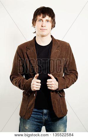 Handsome Man with dark hair Wearing a Corduroy Coat