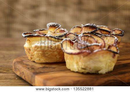 apple shaped rose dessert on wooden table