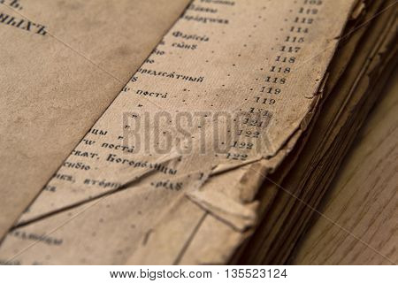 Antique ortodox scripture book with creased pages close-up
