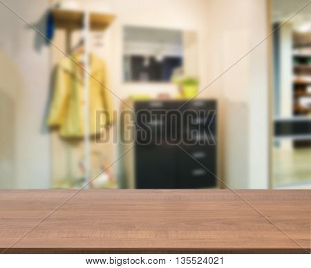 Wooden empty table in front of blurred background. Perspective dark wood over blur in modern apartment interior. Mock up for display or montage your products