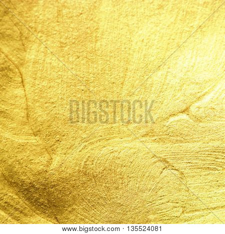 Gold Texture. Golden foil as abstract textured background. Gold painted background