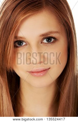 Pretty teenager girl smiling in cheerful mood
