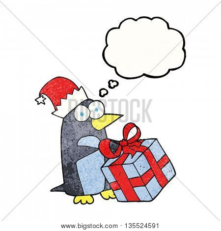 freehand drawn thought bubble textured cartoon christmas penguin