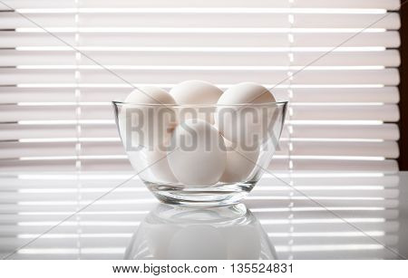 White Eggs In Glass Bowl