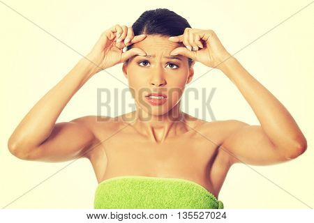 Woman covered with towel.