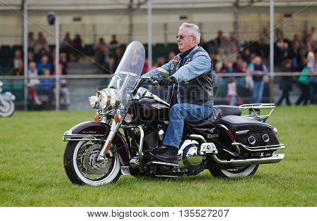 NEWBURY, UK - SEPTEMBER 21: Members of a local Oxfordshire Harley Davidson motorcycle owners club parade around the main arena for the public at the Berks County show on September 21, 2013 in Newbury