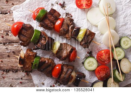 Delicious Kebab With Vegetables On Skewers Close-up. Horizontal Top View