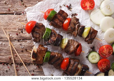 Shish Kebab On Skewers With Vegetables Close-up. Horizontal Top View