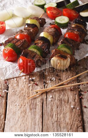 Roasted Meat With Vegetables On Skewers Close-up. Vertical