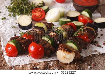 Meat With Vegetables On Skewers Close-up On The Table. Horizontal