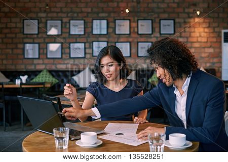 Business man meeting with consultant in cafe