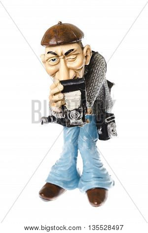funny statuette of an old vintage photographer with multiple cameras in operation