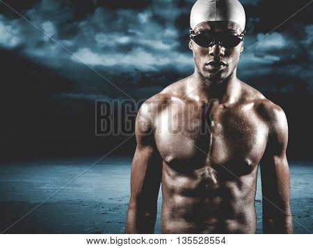 Swimmer ready to dive against dark cloudy sky