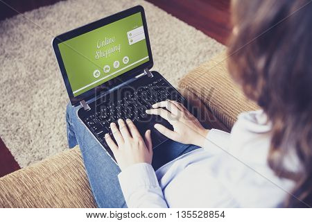 Online shopping website in a laptop screen. Woman buying by internet at home.