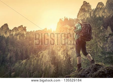 Woman hiking around mountains at spreeng time.