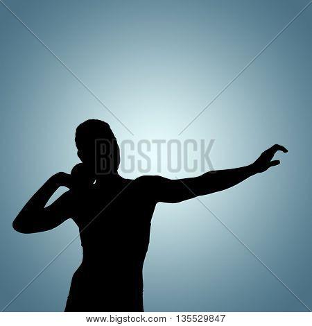 Front view of sportswoman practicinga shot put against grey vignette