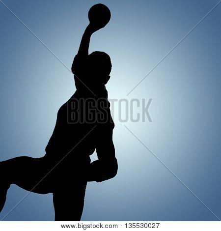 Female athlete throwing handball against purple vignette