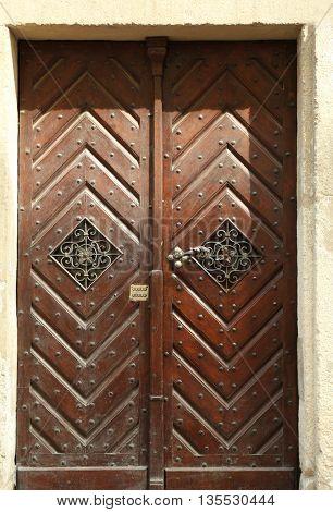 Brown wood old door in the street