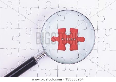 Business Concept - Magnifier Glass on white puzze with VISION Word