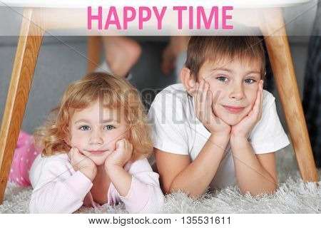 Text Happy Time and cute little children playing under table