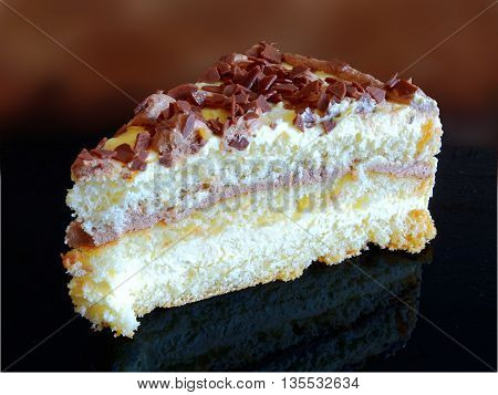 a delicious cake with multiple layers, dough, whipped cream and a delicious cream